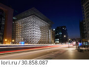 Купить «Brussels, Brussels-Capital Region, Belgium - Illuminated European Building in the European Quarter in the evening.», фото № 30858087, снято 1 апреля 2019 г. (c) Caro Photoagency / Фотобанк Лори