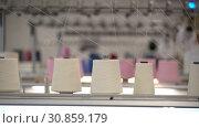 Купить «Spools of white thread on knitting device view», видеоролик № 30859179, снято 25 мая 2019 г. (c) Гурьянов Андрей / Фотобанк Лори