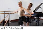 Купить «Ballet partners dancing gracefully together in the ballet studio», фото № 30859831, снято 26 апреля 2019 г. (c) Яков Филимонов / Фотобанк Лори