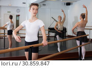 Positive teenager practicing at the ballet barre. Стоковое фото, фотограф Яков Филимонов / Фотобанк Лори