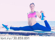 Купить «Woman practicing set of stretching for split», фото № 30859891, снято 6 мая 2017 г. (c) Яков Филимонов / Фотобанк Лори