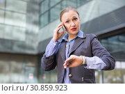 Купить «Portrait of busy female rushing to important meeting», фото № 30859923, снято 6 мая 2017 г. (c) Яков Филимонов / Фотобанк Лори
