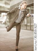 Купить «Portrait of busy female rushing to important meeting», фото № 30859927, снято 6 мая 2017 г. (c) Яков Филимонов / Фотобанк Лори
