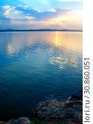 Купить «Summer sunset landscape - stone cliff and lake lit by cold evening light. Dramatic summer landscape», фото № 30860051, снято 16 августа 2013 г. (c) Зезелина Марина / Фотобанк Лори