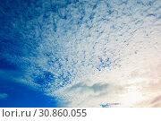 Купить «Sunset colorful sky background - blue dramatic colorful clouds lit by evening sunshine, panoramic sky view», фото № 30860055, снято 15 октября 2015 г. (c) Зезелина Марина / Фотобанк Лори