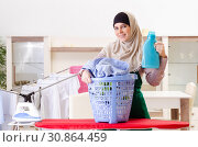 Купить «Woman in hijab doing clothing ironing at home», фото № 30864459, снято 10 декабря 2018 г. (c) Elnur / Фотобанк Лори