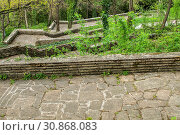 Купить «Paths with stairs in park covered with stone slabs in springtime», фото № 30868083, снято 20 января 2020 г. (c) easy Fotostock / Фотобанк Лори