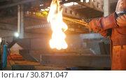 Купить «A man ignites a fuse welding machine. Flames breaking out», видеоролик № 30871047, снято 24 июля 2019 г. (c) Константин Шишкин / Фотобанк Лори