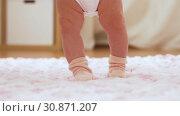 Купить «baby's feet stepping on knitted plush blanket», видеоролик № 30871207, снято 25 мая 2019 г. (c) Syda Productions / Фотобанк Лори