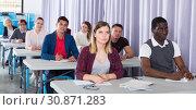 Купить «Adult students listening in classroom», фото № 30871283, снято 8 мая 2018 г. (c) Яков Филимонов / Фотобанк Лори