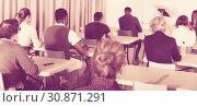 Купить «Back view of students in classroom», фото № 30871291, снято 8 мая 2018 г. (c) Яков Филимонов / Фотобанк Лори