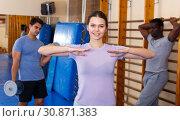 Купить «People warming up at gym», фото № 30871383, снято 31 октября 2018 г. (c) Яков Филимонов / Фотобанк Лори
