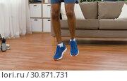 Купить «indian man running on spot at home», видеоролик № 30871731, снято 27 мая 2019 г. (c) Syda Productions / Фотобанк Лори
