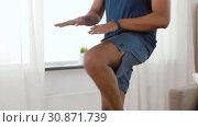 Купить «african american man jumping on spot at home», видеоролик № 30871739, снято 27 мая 2019 г. (c) Syda Productions / Фотобанк Лори