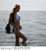 Portrait of a beautiful slim sexy blonde on the sea beach in the water resting on a tropical resort. Стоковое фото, фотограф katalinks / Фотобанк Лори