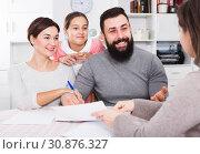Купить «Parents signing property papers», фото № 30876327, снято 23 ноября 2019 г. (c) Яков Филимонов / Фотобанк Лори