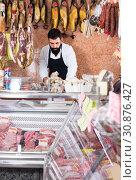 Купить «assistant arranging meat», фото № 30876427, снято 16 ноября 2016 г. (c) Яков Филимонов / Фотобанк Лори