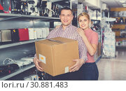 Купить «Couple with packed purchases in household appliances section in shop», фото № 30881483, снято 1 марта 2018 г. (c) Яков Филимонов / Фотобанк Лори