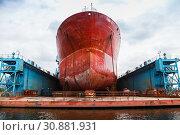 Купить «Huge red tanker is in floating dock», фото № 30881931, снято 16 июля 2014 г. (c) EugeneSergeev / Фотобанк Лори