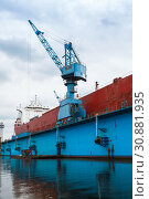 Купить «Red tanker is under repair», фото № 30881935, снято 16 июля 2014 г. (c) EugeneSergeev / Фотобанк Лори