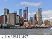 Купить «Financial District of Lower Manhattan viewed from Brooklyn Bridge Park Pier. New York City, US», фото № 30881967, снято 8 мая 2019 г. (c) Валерия Попова / Фотобанк Лори