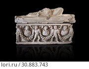 Roman relief garland sculpted sarcophagus, style typical of Pamphylia, 3rd Century AD, Konya Archaeological Museum, Turkey. Against a black background. (2018 год). Редакционное фото, фотограф Funkystock / age Fotostock / Фотобанк Лори