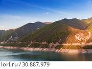 Купить «Zhinvali reservoir in evening sun», фото № 30887979, снято 1 мая 2019 г. (c) EugeneSergeev / Фотобанк Лори