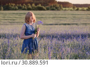 Купить «beautiful teenager girl in summer field with cornflower», фото № 30889591, снято 6 июня 2019 г. (c) Майя Крученкова / Фотобанк Лори