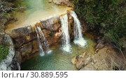 Купить «El Torrent de la Cabana small mountain stream with crystal clear water», видеоролик № 30889595, снято 23 марта 2018 г. (c) Яков Филимонов / Фотобанк Лори