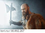Купить «Angry viking with axe, martial spirit, barbarian», фото № 30892267, снято 27 марта 2019 г. (c) Tryapitsyn Sergiy / Фотобанк Лори