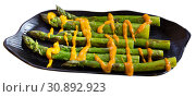 Купить «Grilled green asparagus with Romesk sauce», фото № 30892923, снято 20 июля 2019 г. (c) Яков Филимонов / Фотобанк Лори
