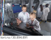 Купить «five kids solve task in the bunker quest room», фото № 30894891, снято 21 октября 2017 г. (c) Яков Филимонов / Фотобанк Лори