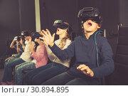 Купить «Enthusiastic children in virtual reality glasses in quest room», фото № 30894895, снято 21 октября 2017 г. (c) Яков Филимонов / Фотобанк Лори