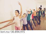Купить «Young ballet dancers exercising in ballroom», фото № 30894915, снято 12 ноября 2016 г. (c) Яков Филимонов / Фотобанк Лори