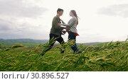 Young couple have a hug in yhe meadow, man makes an offer to get married. Стоковое видео, видеограф Константин Шишкин / Фотобанк Лори