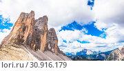 Купить «The three peaks, from left to right : Cima Piccola (2857 m), Cime Grande (2999 m), Cima Ovest (2973m).», фото № 30916179, снято 20 июня 2019 г. (c) easy Fotostock / Фотобанк Лори