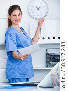 Купить «Female doctor near shelves in office», фото № 30917243, снято 31 июля 2017 г. (c) Яков Филимонов / Фотобанк Лори