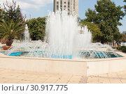 Купить «VARNA, BULGARIA - AUGUST 14, 2015: Fountain on boulevard of princes Maria-Luiza near City Council», фото № 30917775, снято 14 августа 2015 г. (c) ИВА Афонская / Фотобанк Лори