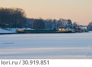Ship boat caught in frozen sea icebound ice snow harbor. Стоковое фото, фотограф YAY Micro / easy Fotostock / Фотобанк Лори
