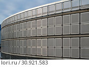 Купить «Round shaped parking lot, four floors. Shiny steel net walls.», фото № 30921583, снято 1 января 2012 г. (c) easy Fotostock / Фотобанк Лори