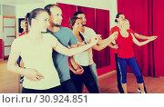 Купить «Smiling adults dancing bachata together», фото № 30924851, снято 17 июля 2019 г. (c) Яков Филимонов / Фотобанк Лори