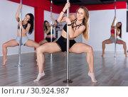 Купить «Sexy young women practicing pole dancing in fitness studio», фото № 30924987, снято 5 апреля 2018 г. (c) Яков Филимонов / Фотобанк Лори