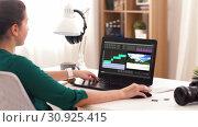 Купить «woman with video editor program on laptop at home», видеоролик № 30925415, снято 21 сентября 2019 г. (c) Syda Productions / Фотобанк Лори
