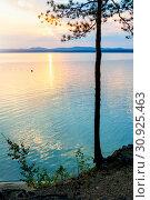 Купить «Summer sunset landscape - stone cliff and lake lit by sunset light. Colorful summer landscape sunset scene», фото № 30925463, снято 16 августа 2013 г. (c) Зезелина Марина / Фотобанк Лори