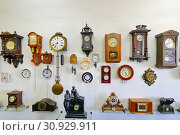 Купить «A collection of antique watches of various shapes and sizes placed on a white wall in the museum's premises.», фото № 30929911, снято 6 августа 2013 г. (c) easy Fotostock / Фотобанк Лори