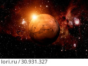 Купить «Solar System - Mars. It is the fourth planet from the Sun. Mars is a terrestrial planet with a thin atmosphere, having craters, volcanoes, valleys, deserts. Elements of this image furnished by NASA.», фото № 30931327, снято 27 мая 2020 г. (c) easy Fotostock / Фотобанк Лори