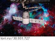 Купить «SpaceX Dragon orbiting the planet Earth. Elements of this image furnished by NASA.», фото № 30931727, снято 27 мая 2020 г. (c) easy Fotostock / Фотобанк Лори