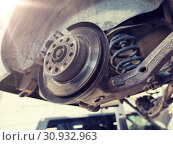 Купить «car brake disc at repair station», фото № 30932963, снято 1 июля 2016 г. (c) Syda Productions / Фотобанк Лори