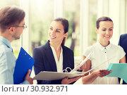 Купить «business team with folders meeting at office», фото № 30932971, снято 3 июля 2016 г. (c) Syda Productions / Фотобанк Лори