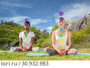 Купить «couple doing yoga in lotus pose with seven chakras», фото № 30932983, снято 6 августа 2014 г. (c) Syda Productions / Фотобанк Лори